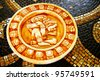 Carved stone Mayan calendar on tile background - stock photo