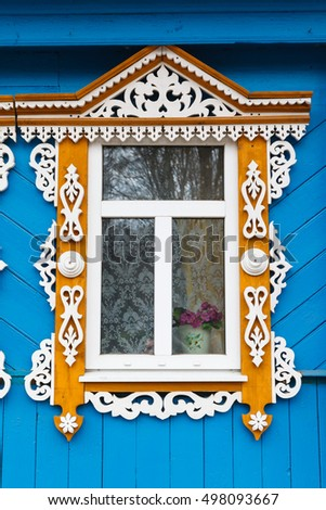 Carved window of old wooden house