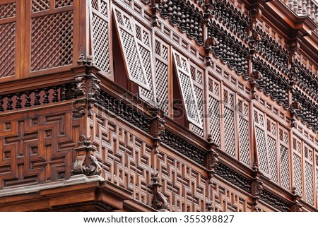 carved wooden balcony of the old house
