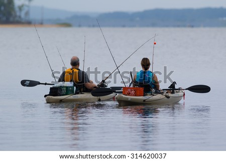 CARY, NORTH CAROLINA - SEPT 7: Retired couple readies for a day of fishing and kayaking on 7 Sept 2015 at Lake Jordan