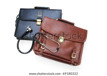 Cases and stethoscope isolated on the white