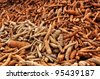 Cassava on the floor waiting for the transport. - stock photo