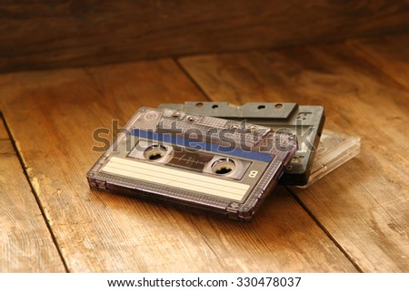 Cassette tape over wooden table. image is filtered.