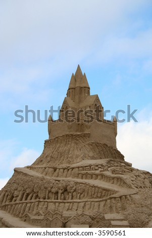 Castle and mountain road from sand against a blue sky. Public sand exhibition, Lapeenranta, Finland