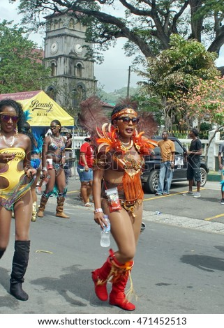 CASTRIES, SAINT LUCIA - CIRCA JULY 2015: Brightly costumed dancers in the Carnival Parade in the capital