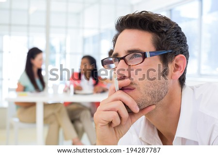 Casual businessman with glasses concentrating in the office
