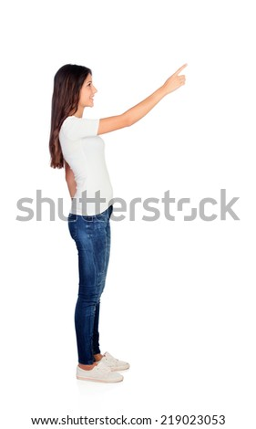 Casual girl pointing something at side isolated on a white background