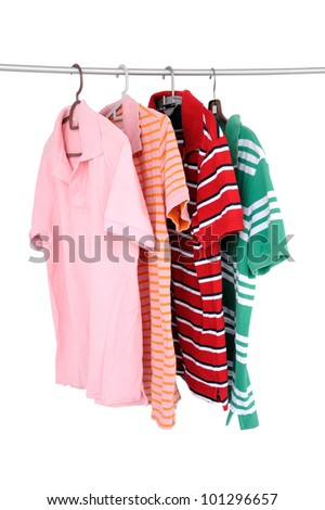 Casual shirts on the rack, isolated on white background, selective focus.