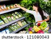 Casual woman grocery shopping at the supermarket - stock photo