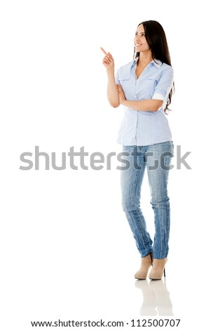 Casual woman pointing with her finger - isolated over a white background
