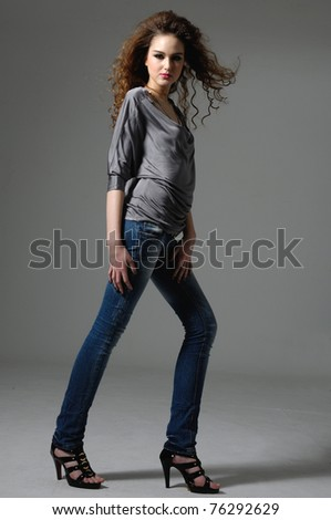 casual woman smiling isolated over gray background