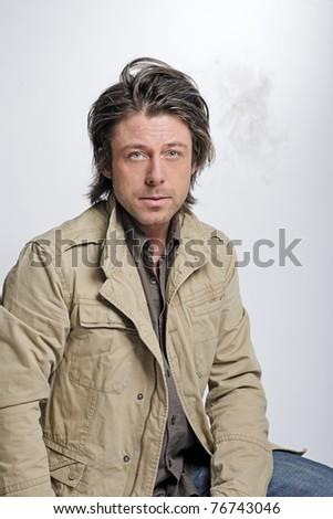 man half long hair smoking cigarette. Angry young man. - stock ...