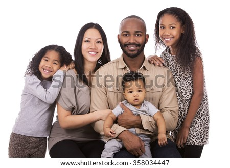casual young mixed family on white isolated background