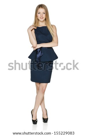 Casually standing carefree businesswoman in full length against white background