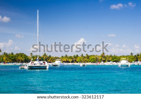 Catamarans landing in the harbor of tropical beach in Bayahibe, Dominican Republic