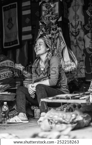 CATCAT, VIETMAN - SEP 20, 2014: Unidentified Hmong woman sells clothes  in Catcat village, Vietnam. Hmong is a minority ethnic group of Vietnam