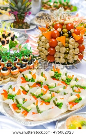 Catering buffet style for banquet. Beautiful served for festive dinner snacks and appetizers, tartine and canape. Restaurant food, Wedding table.