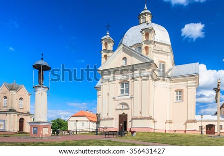 Catholic church of the Holy Trinity and the column with a statue of Saint Agatha. Liskiava. Lithuania