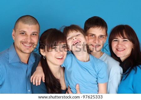 Caucasian bliss beautiful family consisting of five people together on a blue background