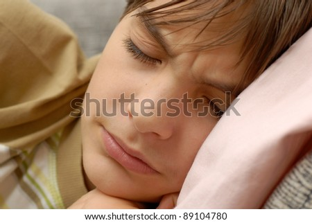 caucasian boy portrait, dreaming bad dreams closeup