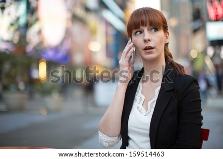 Caucasian business woman in New York City calling talking on phone cellphone