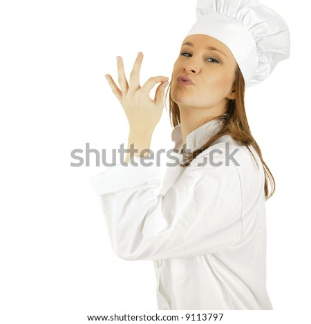 caucasian chef making tip with her hand in front of mouth to symbolize deliciousness