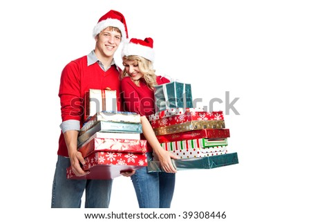 Caucasian couple doing christmas shopping and carrying gifts