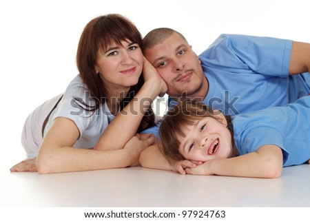 Caucasian good beautiful family consisting of three people fool around on a white background