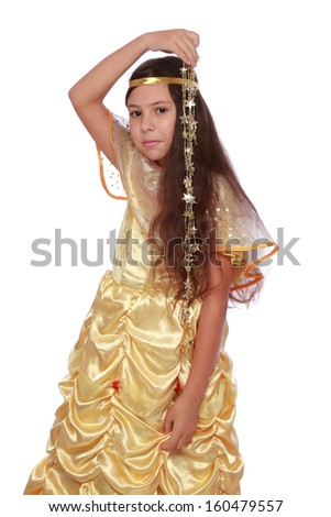 Caucasian happy girl with beautiful dark hair in a golden fancy dress holding gold star on Holiday