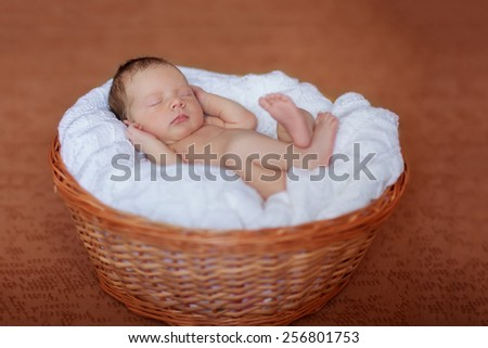 Caucasian newborn baby while sleeping closeup
