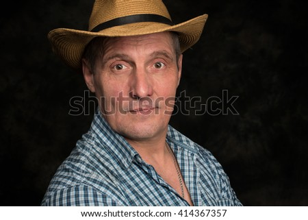 Caucasian senior man of 60 years old standing against gray background