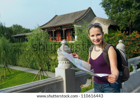 Caucasian woman with map and backpack travel in China. Student travel during summer holiday