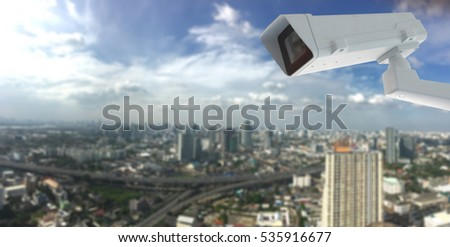 cctv camera with city in background