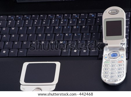 cell phone sitting on a laptop