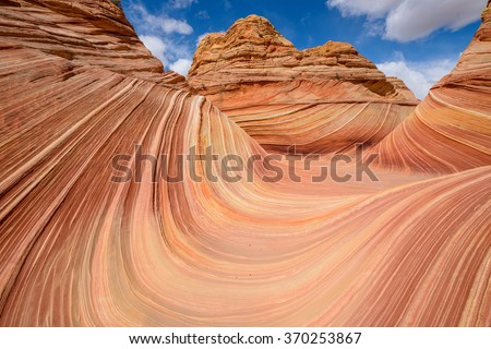 "Center view of ""The Wave"" - a dramatic and colorful erosional sandstone rock formation located in North Coyote Buttes area of Paria Canyon-Vermilion Cliffs Wilderness at Arizona-Utah border."