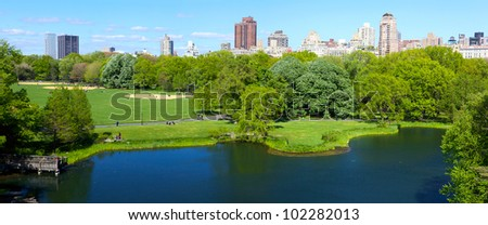 Central Park panorama with Manhattan skyscrapers over Turtle Pond, New York