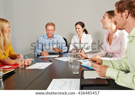 CEO leading business team meeting in conference room