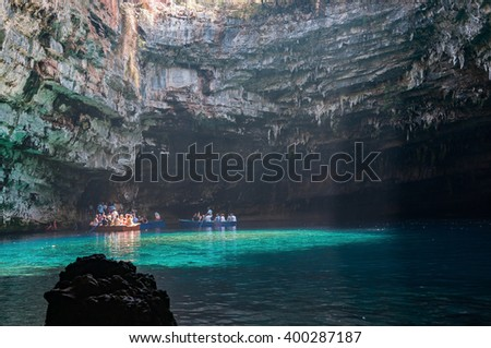 Cephalonia, Greece - August 30, 2015: Tourists take a boat trip on the beautiful Melissani Lake.
