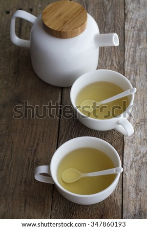 Ceramic cups and teapot with green tea