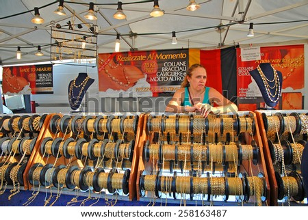 CERVIA, ITALY-SEPTEMBER 21, 2014: necklaces  stand at the annual International food outdoor market. This market is very popular and attract thousands of tourists.