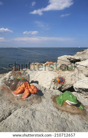 Cesenatico (Forl�¬), Italy, adriatic Sea, some little sculptures carved on the rock of the jetty of the port