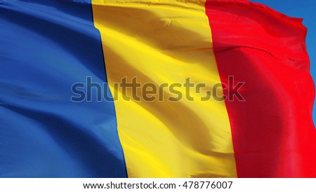 Chad flag waving against clean blue sky, close up, isolated with clipping path mask alpha channel transparency
