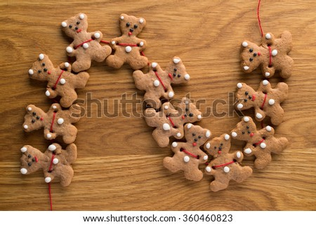 Chained ginger bears laid out on patterned wooden board