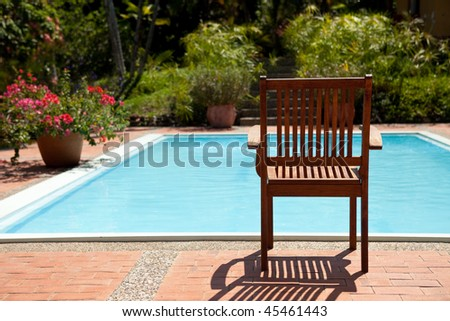 Chair by the poolside in a relaxed sunny atmosphere