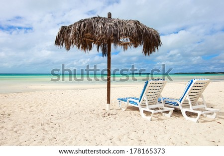 Chairs and umbrella on a beautiful Caribbean beach on Bahamas