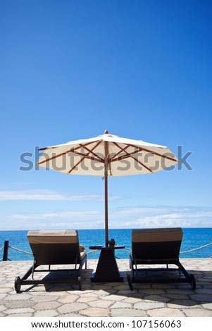 Chairs and Umbrella with Sea View