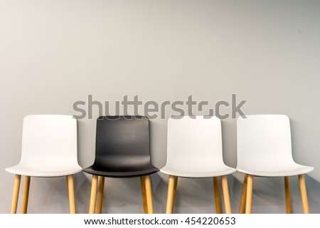 Chairs In Modern Design Arranged In Front Of The Gradient Grey Wall For  Interior Or Graphic