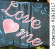 Chalk drawing - love me - stock photo