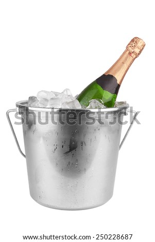 Champagne bottle in ice isolated on white background