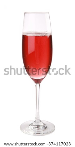 Champagne cocktail with cherry juice on white background
